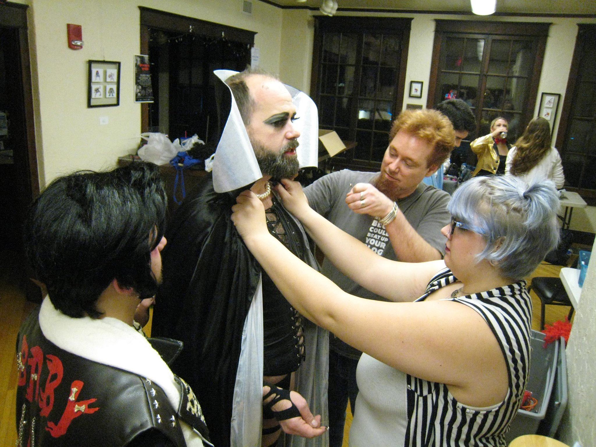Ken Van Egdon aka Dr. Frank-N-Furter, tries on his new cape. :)